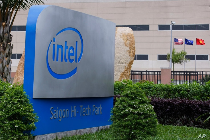 FILE - The logo of Intel Corp. is set up at its assembly and test facility at Saigon High Tech Park, Ho Chi Minh city, Vietnam.