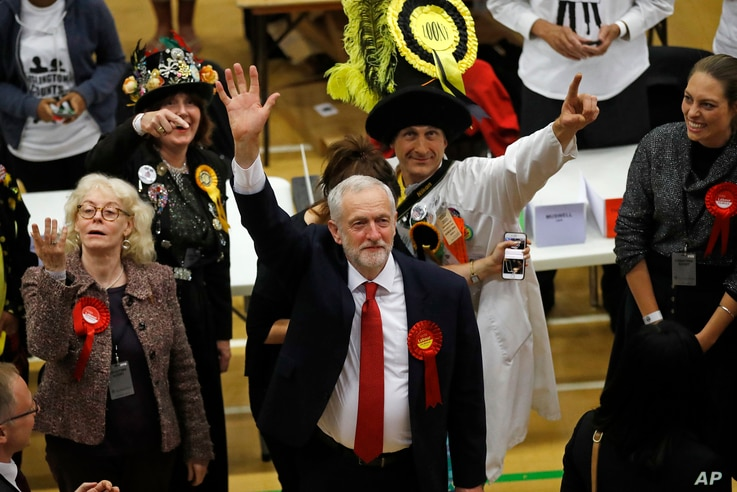 Britain's Labor Party leader Jeremy Corbyn waves after arriving for the declaration at his constituency in London, June 9, 2017.