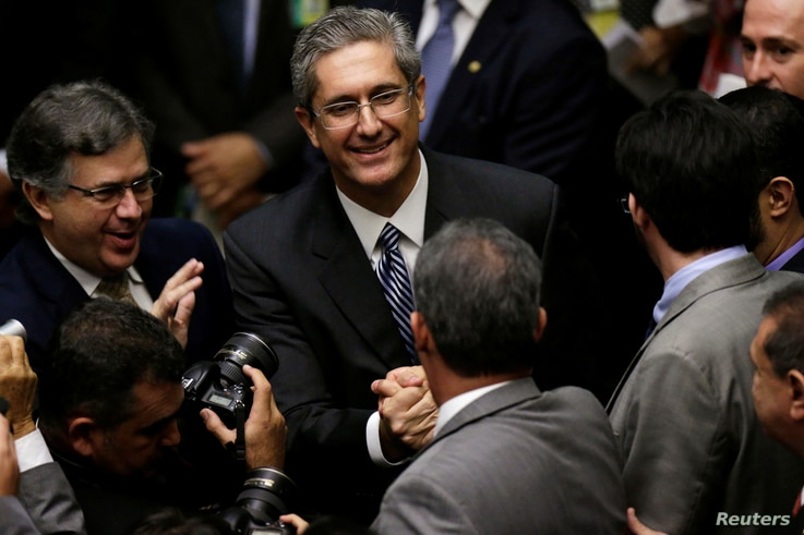Congressman Rogerio Rosso is greeted by congressmen during a session to elect the new president of the chamber of deputies in National Congress in Brasilia, Brazil, July 13, 2016.