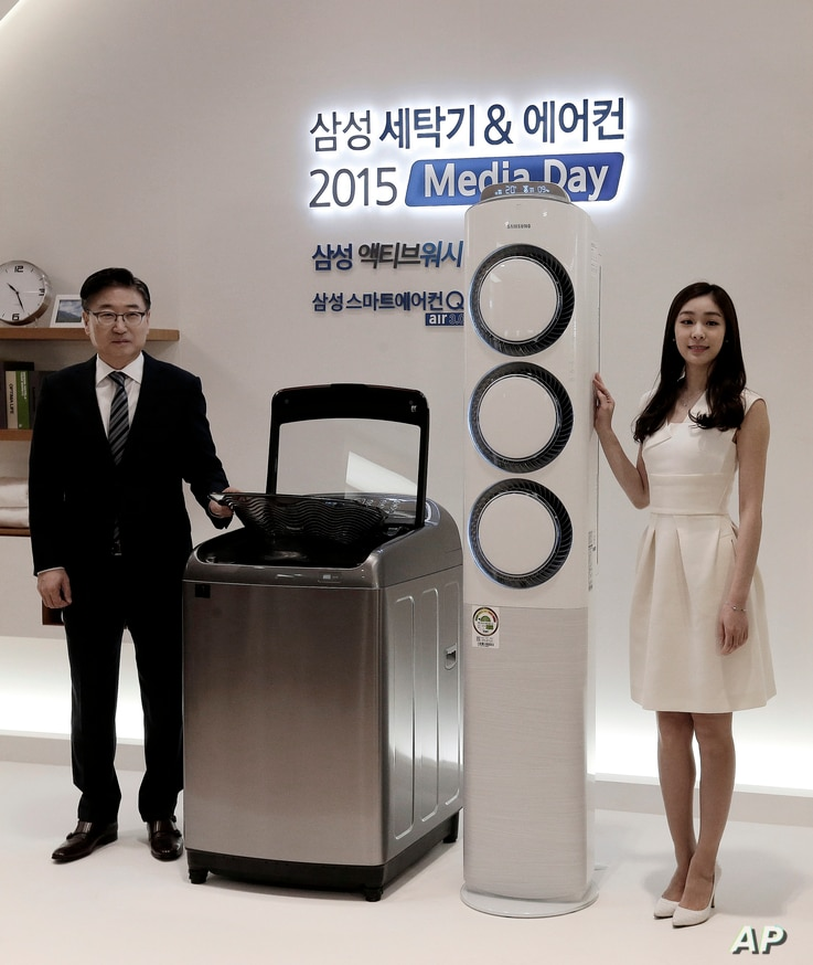 FILE - A Samsung washing machine and  air conditioner are displayed during a media day for unveiling new consumer electronics products in Seoul, South Korea, Feb. 3, 2015.