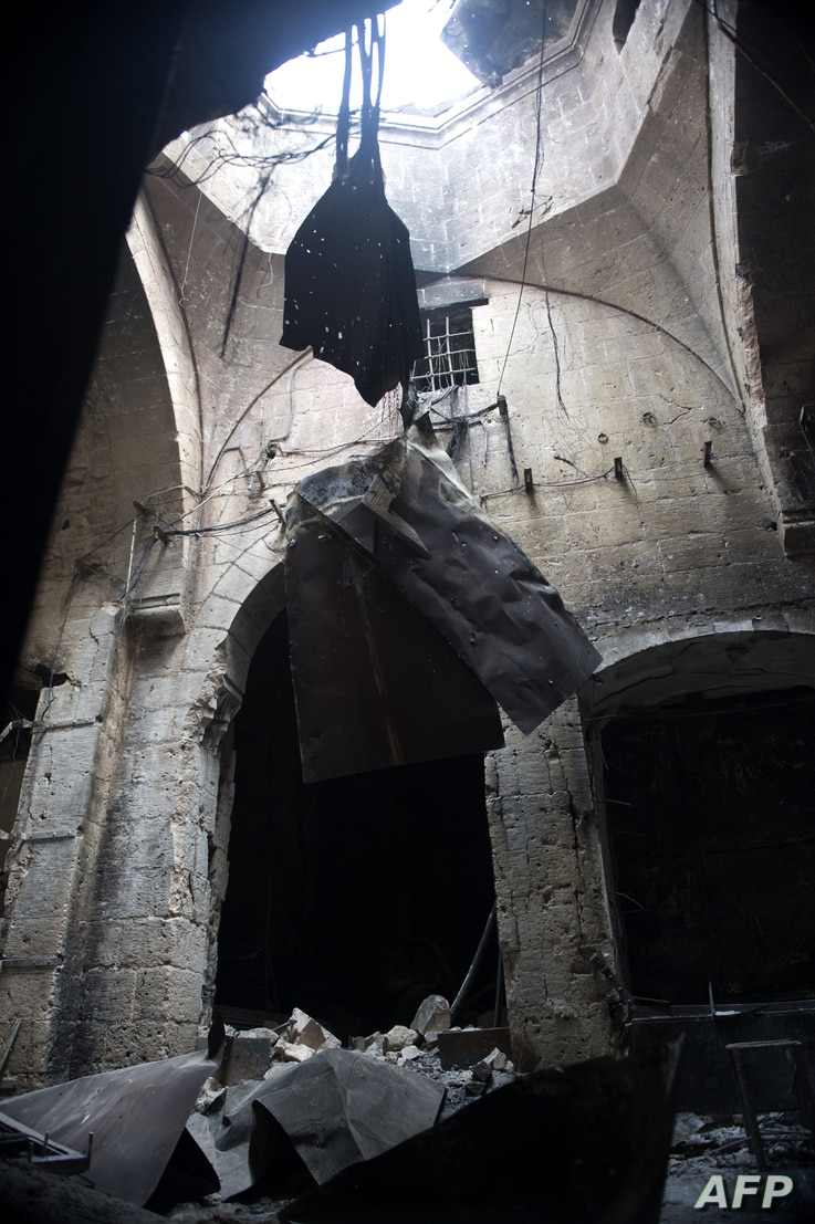 A picture shows damages in a section of the souk in the old city of Aleppo after the area was shelled by Syrian regime forces on September 30, 2012.