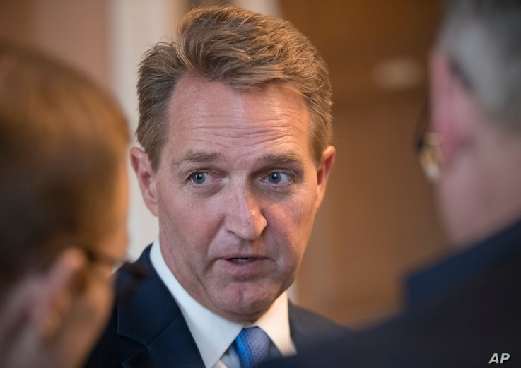 Sen. Jeff Flake, R-Ariz., who announced last year he would not run for re-election in 2018, takes questions from reporters at the Capitol in Washington, Jan. 4, 2018.