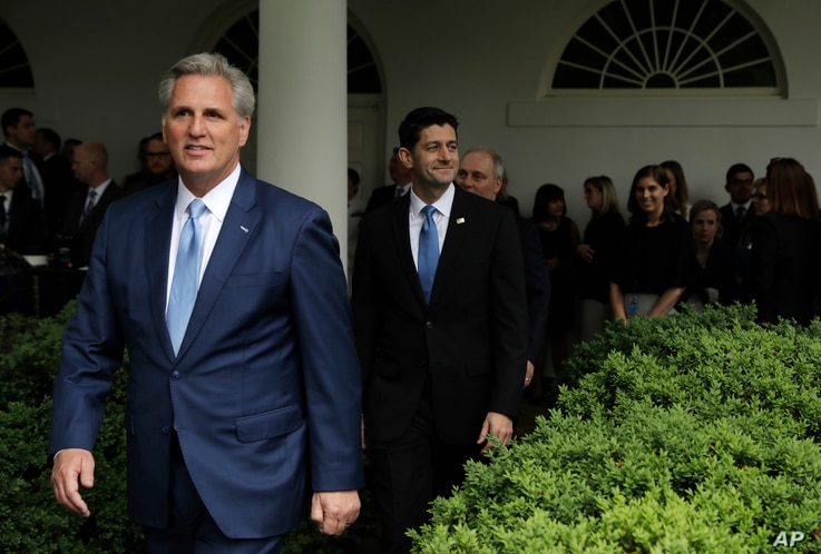House Majority Leader Kevin McCarthy of California, followed by House Speaker Paul Ryan of Wisconsin, and House Majority Whip Steve Scalise of Louisiana, arrive  in the Rose Garden of the White House in Washington, May 4, 2017, after the House pushe...