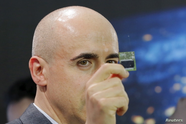 Investor Yuri Milner holds a Starchip, a microelectronic component spacecraft, during an announcement of the Breakthrough Starshot initiative with physicist Stephen Hawking in New York, April 12, 2016.