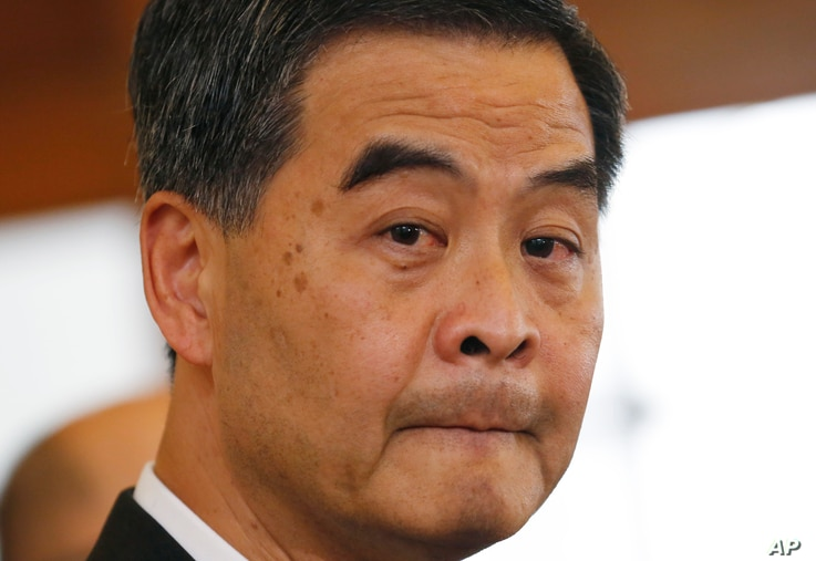 Hong Kong Chief Executive Leung Chun-ying answers questions from media during a press conference in Hong Kong Government House, Oct. 16, 2014.
