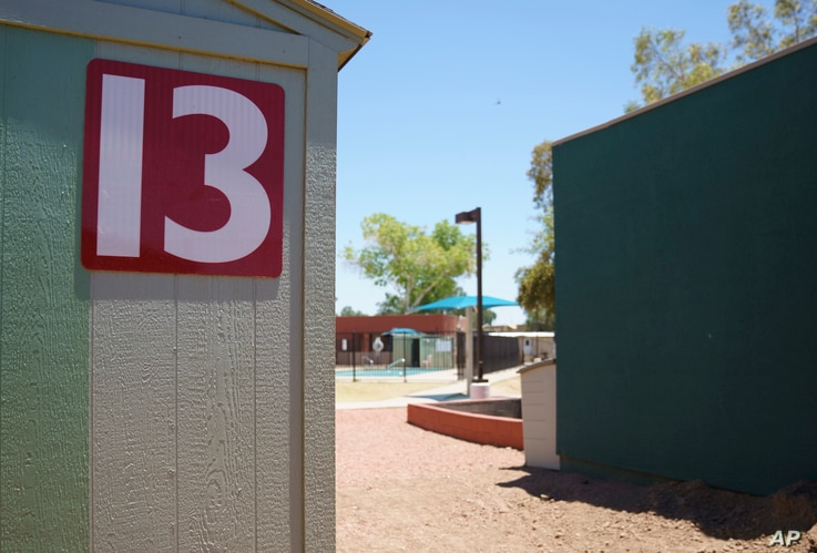 FILE - This June 28, 2018, file photo shows buildings that house juveniles and operations on the grounds of Southwest Key Campbell, a shelter for children that had been separated from their parents in Phoenix. Arizona.