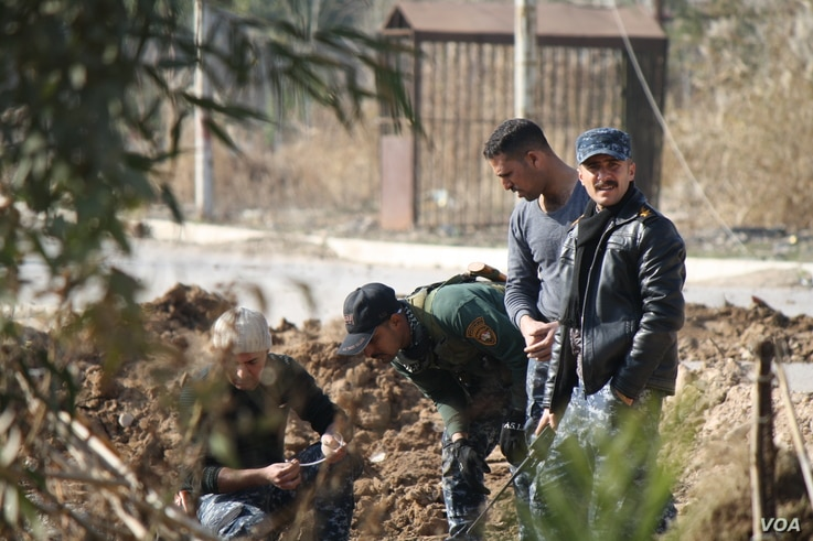 Iraqi forces prepare to detonate a suicide bomber's vest less than a kilometer east of the Tigris River in advance of an assault on IS militants in western Mosul which is expected to begin in the coming days, in Mosul, Iraq, Jan. 13, 2017. (H.Murdock...