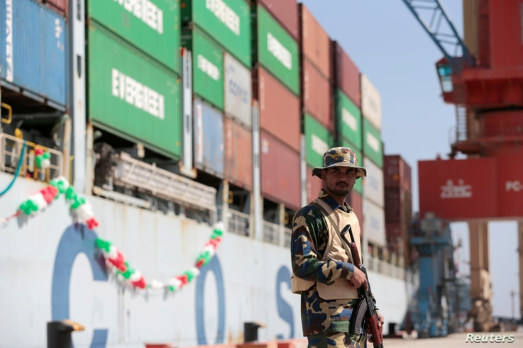 FILE - A soldier stands guard beside the Cosco Wellington, the first container ship to depart after the inauguration of the China Pakistan Economic Corridor port in Gwadar, Pakistan, Nov. 13, 2016.