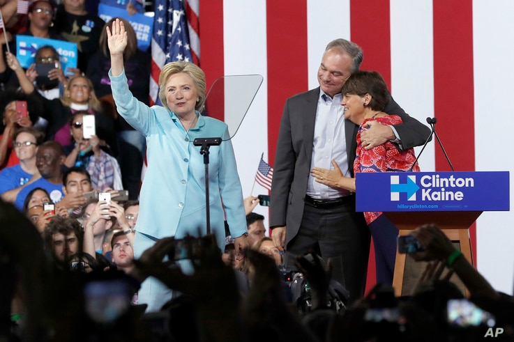 Sen. Tim Kaine, D-Va., hugs his wife Anne Holton during a with Democratic presidential candidate Hillary Clinton at Florida International University Panther Arena in Miami, Saturday, July 23, 2016.