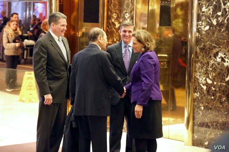 """Retired Lt. General Michael Flynn — Trump's pick for national security adviser — is seen with Maurice """"Hank"""" Greenberg and K.T. McFarland at Trump Tower in New York, Dec. 12, 2016. (R. Taylor/VOA)"""