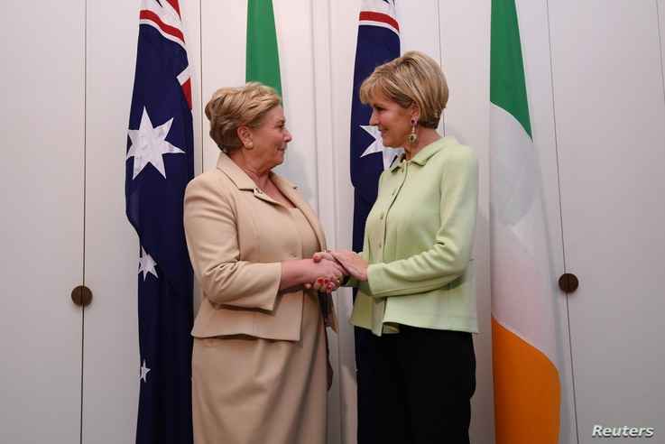 Australian Foreign Minister Julie Bishop, right, shakes hands with Deputy Prime Minister of Ireland Frances Fitzgerald at Parliament House in Canberra, Australia, Oct. 16, 2017.