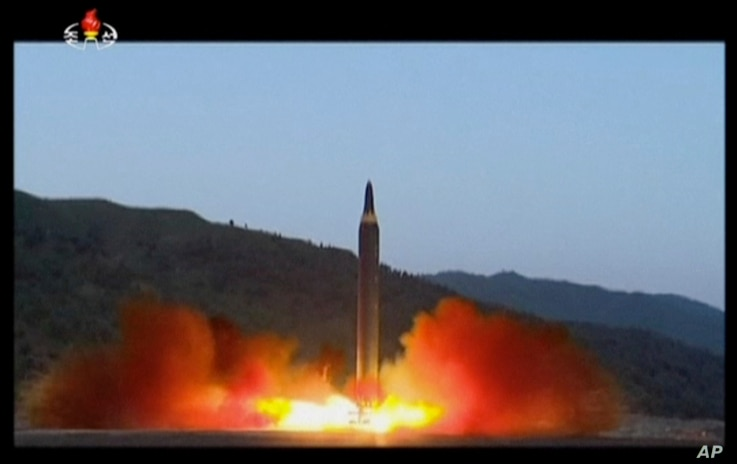 This image made from video of a news bulletin aired by North Korea's KRT on May 15, 2017, shows what was said to be the launch of the Hwasong-12 missile at an undisclosed location in North Korea.