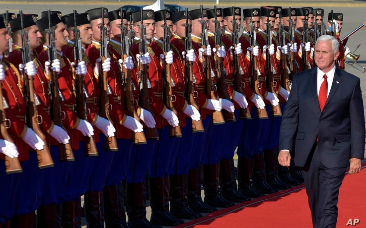 U.S. Vice President Mike Pence attends a welcome ceremony at Golubovci airport, near Podgorica, Montenegro, Aug. 1, 2017. Pence will attend the Adriatic Charter Summit in NATO's newest member — Montenegro, on Wednesday.