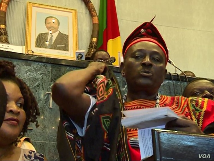 Opposition lawmaker Joseph Mbah Ndam is seen on the rostrum complaining about anglophone marginalization, in Yaounde, Cameroon, April 4, 2017.