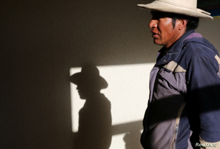 Cipriano Lima talks at his home in the town of Nueva Fuerabamba in Apurimac, Peru, Oct. 2, 2017.