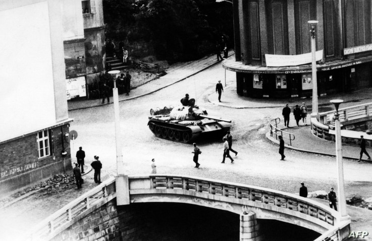 FILE - A photo taken in August 1968 in Trutnov shows a tank as Soviet-led Warsaw Pact troops and tanks invade Czechoslovakia to crush the so-called Prague Spring reform and re-establish a totalitarian regime.