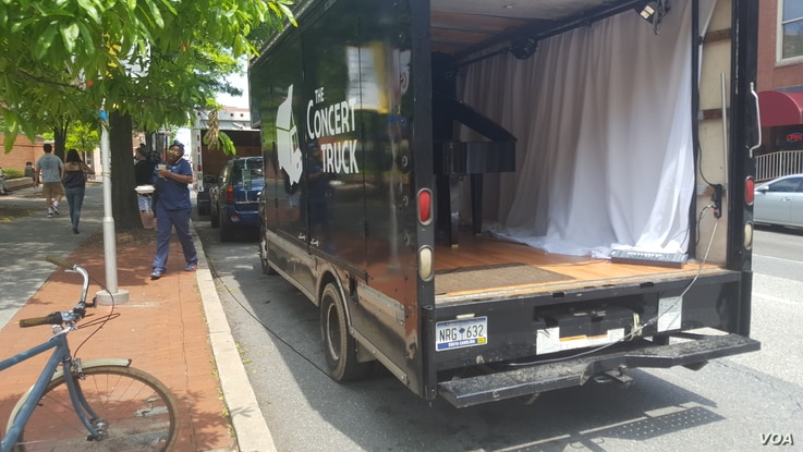 It only takes a few minutes for Luby and Zhang to turn their truck into their stage in the middle of the street.