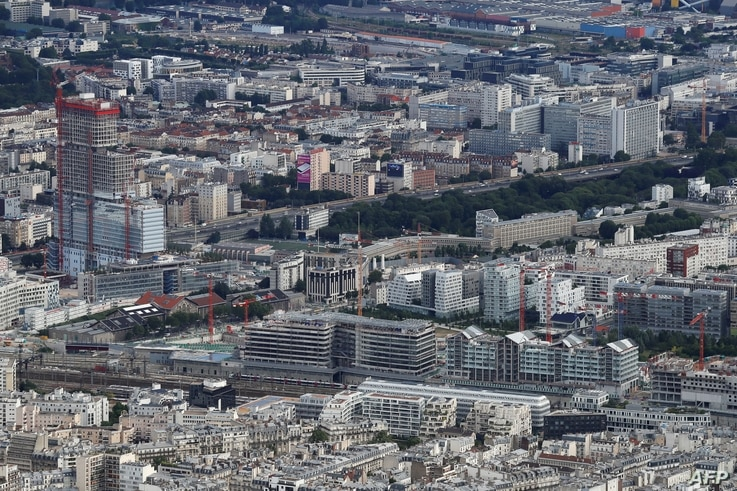 FILE - An aerial view is seen of the construction site of the new Paris courthouse in the urban development zone of Clichy–Batignolles, northwest of Paris, July 14, 2016.