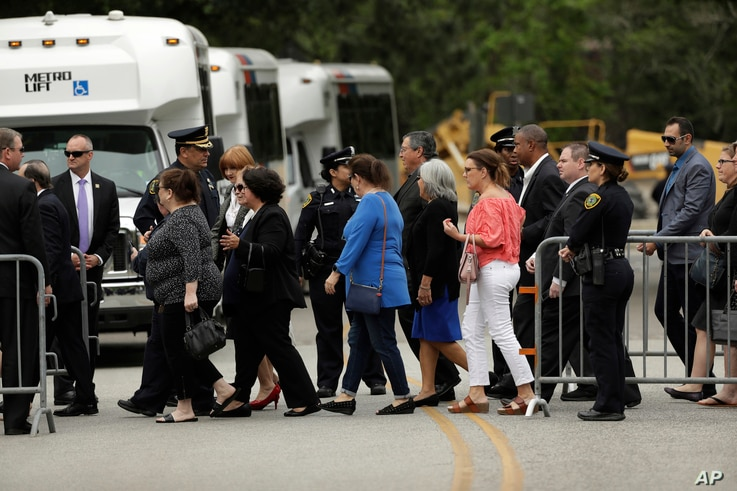 People arrive at St. Martin's Episcopal Church for the visitation of former first lady Barbara Bush, April 20, 2018, in Houston