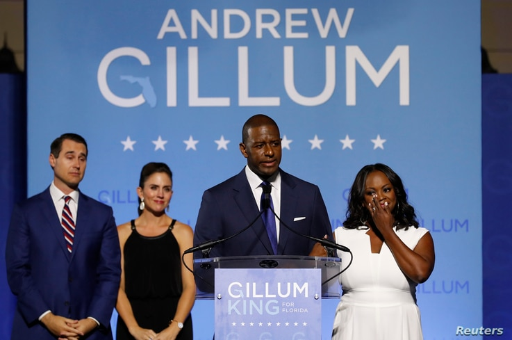 Democratic Florida gubernatorial nominee and Tallahassee Mayor Andrew Gillum concedes the race to U.S. Rep. Ron DeSantis as Gillum's running mate Chris King, left, King's wife Kristin, center, and Gillum's wife R. Jai watch at his side during his mid...