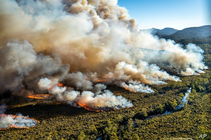 A large bushfire burns in Tasmania, Australia, in this undated photo courtesy of Tasmania Parks and Wildlife Service. AAP Image/Tasmania Parks and Wildlife Service/Handout via REUTERS ATTENTION EDITORS - THIS IMAGE WAS PROVIDED BY A THIRD PARTY. NO R...