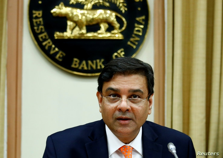 FILE - The Reserve Bank of India (RBI) Governor Urjit Patel attends a news conference in Mumbai, India, Dec. 6, 2017.
