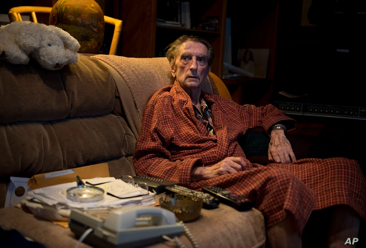 FILE - Harry Dean Stanton poses for a portrait in Los Angeles, Sept. 4, 2013.