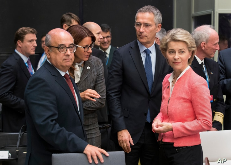 From left, Portuguese Defense Minister Jose Alberto Azeredo Lopes, Slovenian Defense Minister Andreja Katic, NATO Secretary General Jens Stoltenberg and German Defense Minister Ursula von der Leyen chat at the beginning of the informal meeting of the...