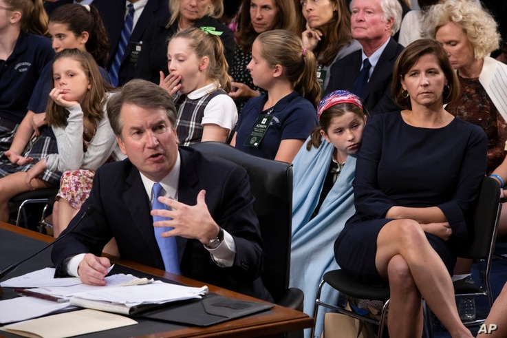 FILE - Supreme Court nominee Brett Kavanaugh testifies before the Senate Judiciary Committee on the third day of his confirmation hearing as he is joined by, from right to left, his wife Ashley Estes Kavanaugh, and their daughters.