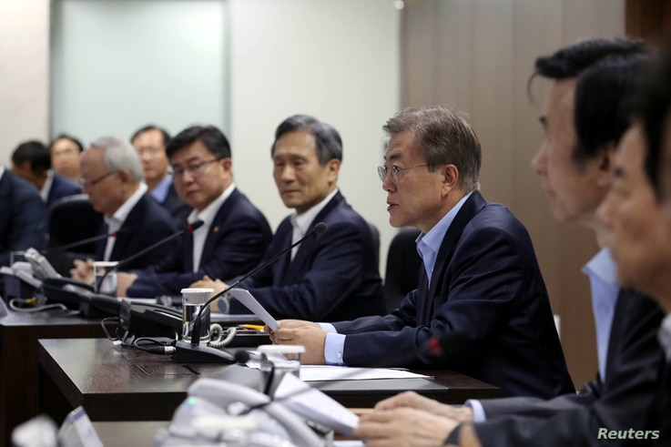 South Korean President Moon Jae-in presides over National Security Council at the Presidential Blue House in Seoul, South Korea, May 14, 2017.