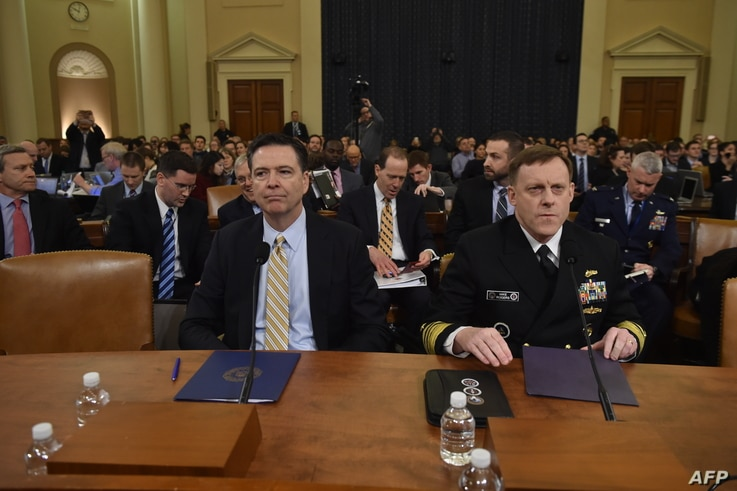 FBI Director James Comey (L) and National Security Agency Director Mike Rogers(R) arrive to speak during the House Permanent Select Committee on Intelligence hearing on Russian actions during the 2016 election campaign on March 20, 2017 on Capitol Hi...