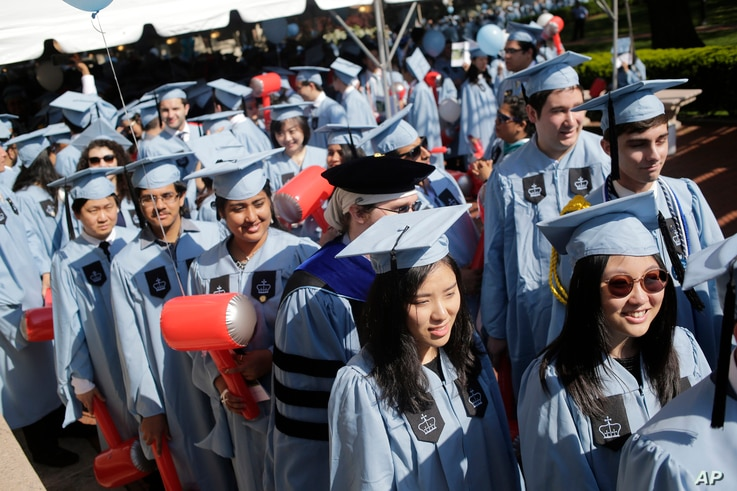 Students participate in a graduation ceremony at Columbia University in New York, May 17, 2017.