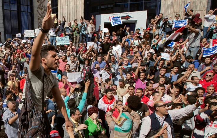 Egyptians shout slogans against Egyptian President Abdel-Fattah el-Sissi during a protest against the decision to hand over control of two strategic Red Sea islands to Saudi Arabia in front of the Press Syndicate, in Cairo, Egypt, Friday, April 15, 2