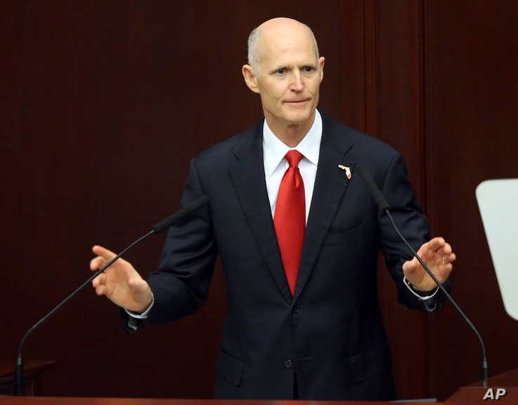Gov. Rick Scott speaks to the Legislature, March 7, 2017, in Tallahassee, Fla. Scott reassigned a case when State Attorney Aramis Ayala said she would no longer seek the death penalty.