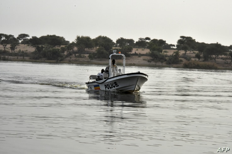 FILE - A boat of the Chadian police sailing on Lake Chad which borders Chad, Nigeria, Niger and Cameroon, in Bol, Jan. 25, 2015.