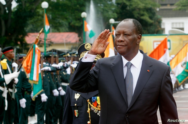 Ivory Coast's President Alassane Ouattara salutes during a parade to commemorate the country's 54th Independence Day, outside the presidential palace in Abidjan, August 7, 2014.