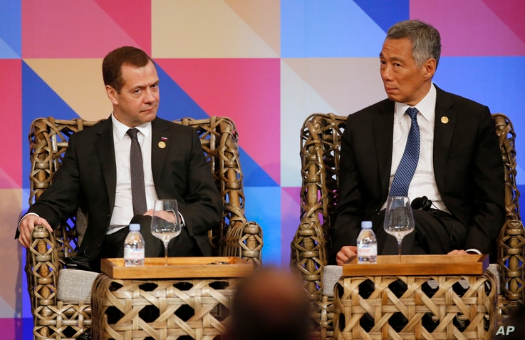 Prime Minister Dmitry Medvedev and Singapore Prime Minister Lee Hsien Loong, right, listen during a ABAC dialogue at the Asia-Pacific Economic Cooperation (APEC) summit in Manila, Philippines Wednesday, Nov. 18, 2015.