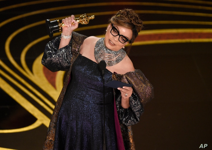 """Ruth E. Carter accepts the award for best costume design for """"Black Panther"""" at the Oscars on Sunday, Feb. 24, 2019, at the Dolby Theatre in Los Angeles."""