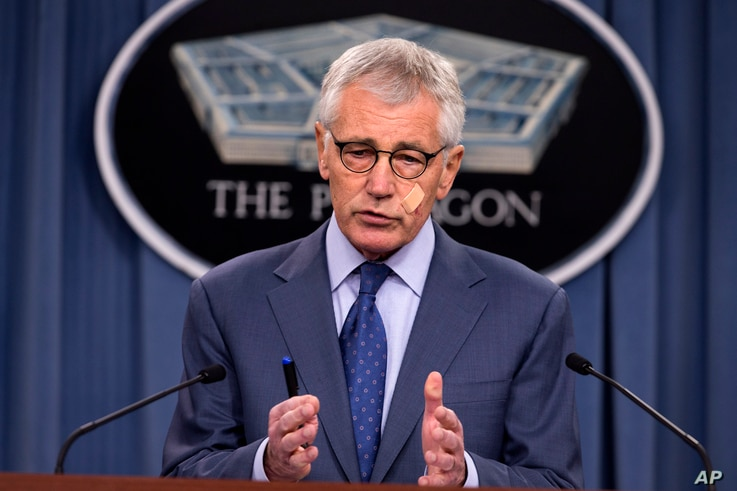 Defense Secretary Chuck Hagel speaks during a news conference at the Pentagon, Friday, Nov. 14, 2014, where he announced that he is ordering top-to-bottom changes in how the nation's nuclear arsenal is managed, vowing to invest billions of dollars mo