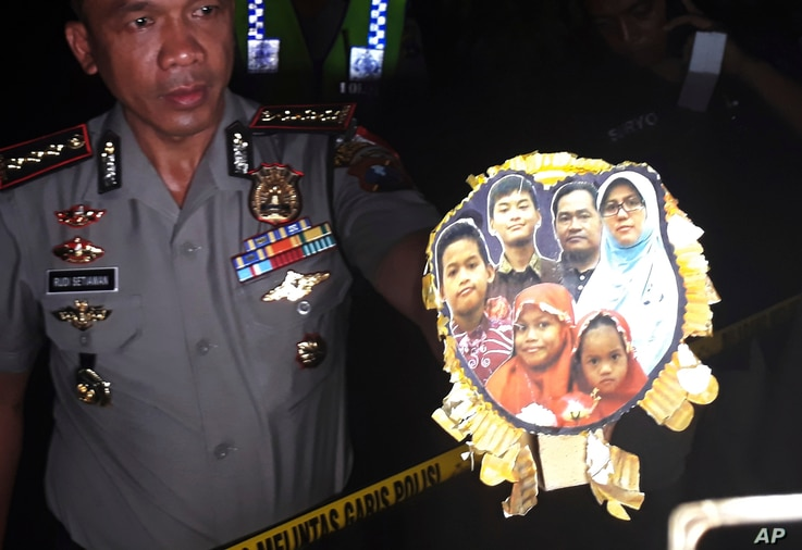 Surabaya Police Chief Col. Rudi Setiawan shows a picture of the family of Dita Oepriarto who carried out the church attacks on May 13, 2018 in Surabaya, East Java, Indonesia.