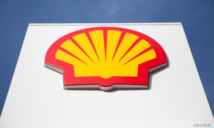 FILE - A logo for Shell is seen on a garage forecourt in central London, Britain, March 6, 2014.