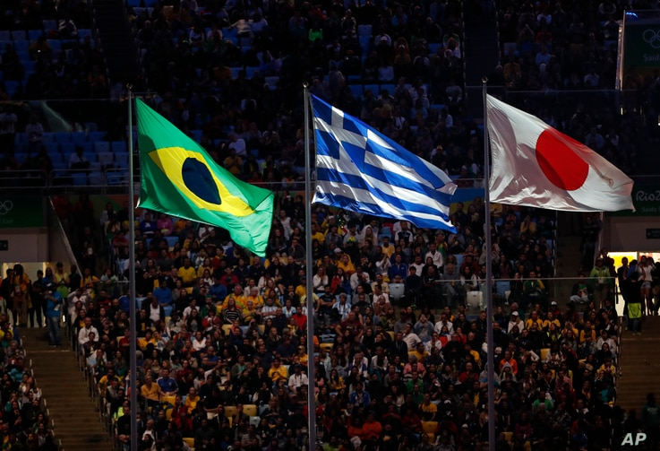 Rio Olympics Closing Ceremony: The flags of Brazil, Greece and Japan fly during the closing ceremony for the Summer Olympics inside Maracana stadium in Rio de Janeiro, Brazil, Sunday, Aug. 21, 2016.