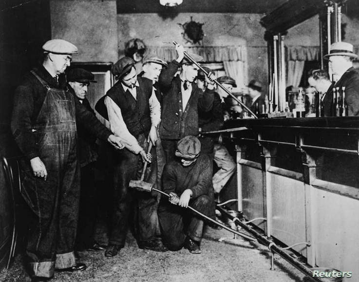 U.S. Prohibition agents destroy a bar in an undated photo held by the National Archives and Records Administration.