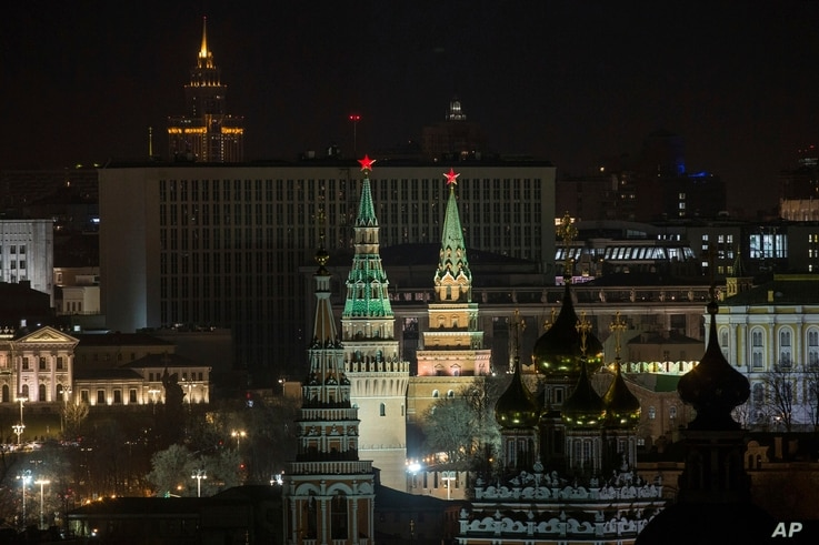 The Kremlin's towers and a church are illuminated before the lights were turned off to mark Earth Hour in Moscow, March 25, 2017.