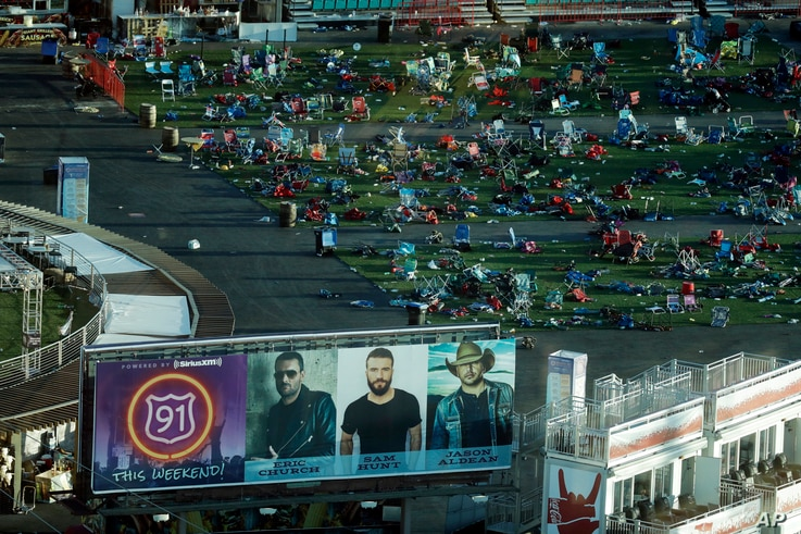FILE - Personal belongings and debris litters the Route 91 Harvest festival grounds across the street from the Mandalay Bay resort and casino in Las Vegas, Oct. 3, 2017.