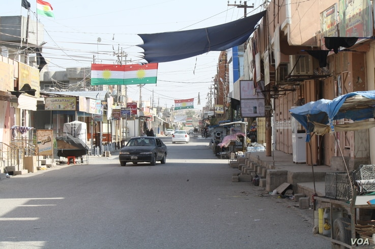 Tur Khurmatu streets are empty after a night of fighting and some families are already fleeing the violence on Oct. 14, 2017 in Turk Khurmatu, Iraq.