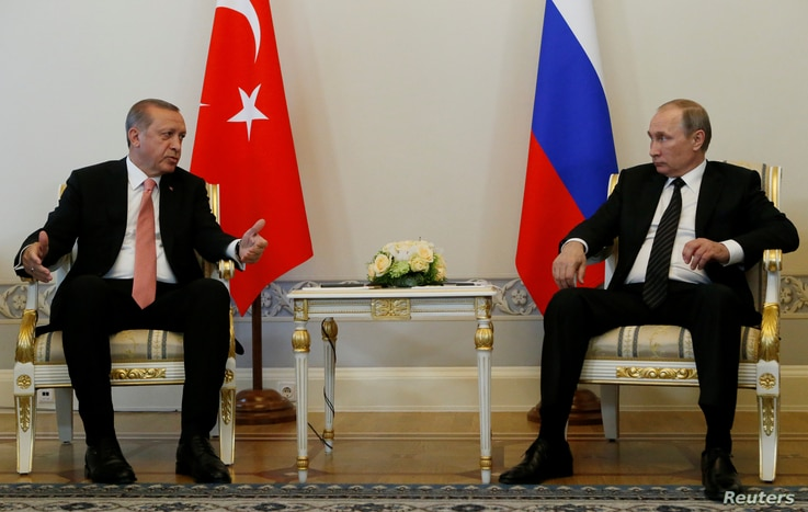 Turkish President Tayyip Erdogan speaks to Russian President Vladimir Putin