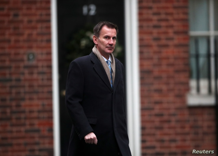 FILE - Britain's Foreign Secretary Jeremy Hunt arrives in Downing Street, London, Britain, Dec. 18, 2018.