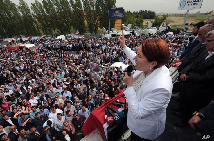 Meral Aksener. a former Interior minister, addresses supporters as riot police sealed off a hotel to prevent thousands of dissidents from holding a party congress in Ankara, Turkey, May 15, 2016.