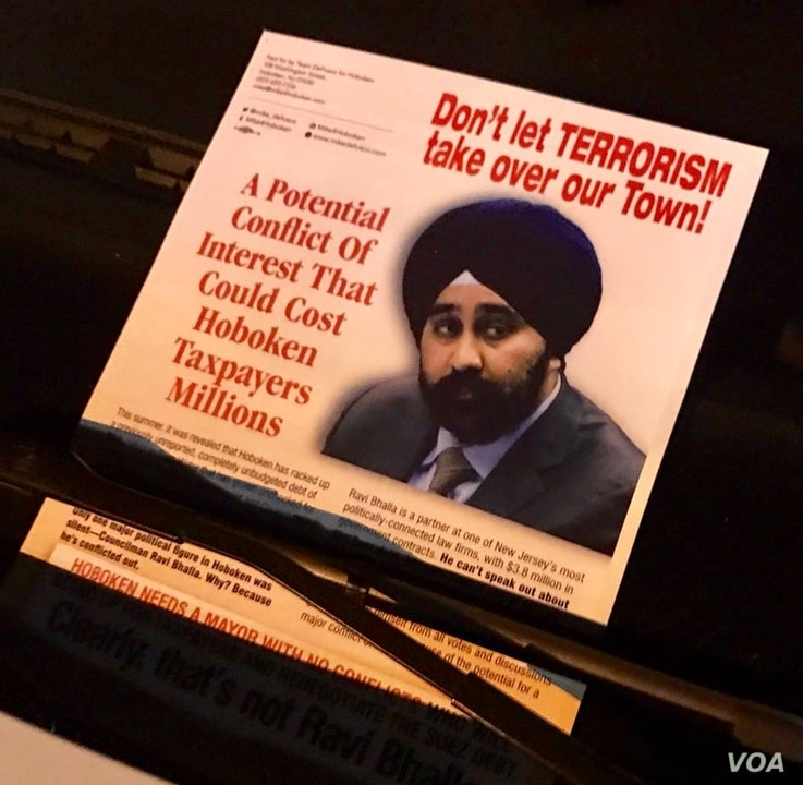 A campaign poster labeled turbaned Sikh Ravi Bhalla as a terrorist.